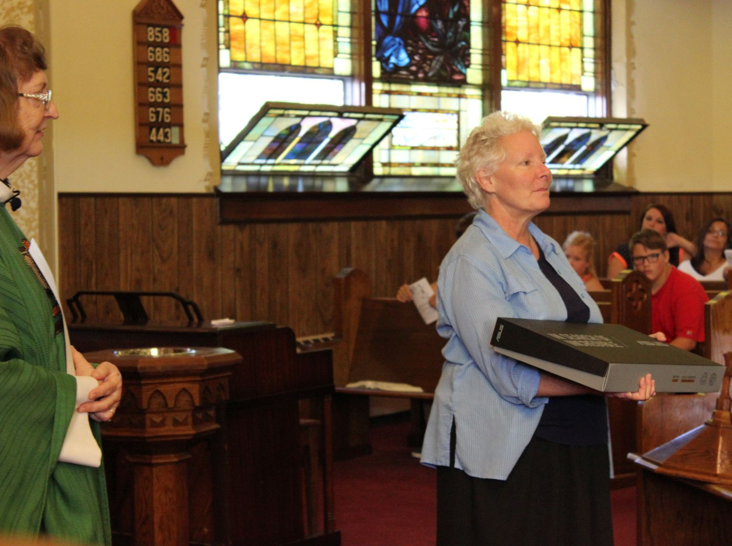 Kathleen Lutz receives laptop for Kenya mission work, 18 Sep 2016.