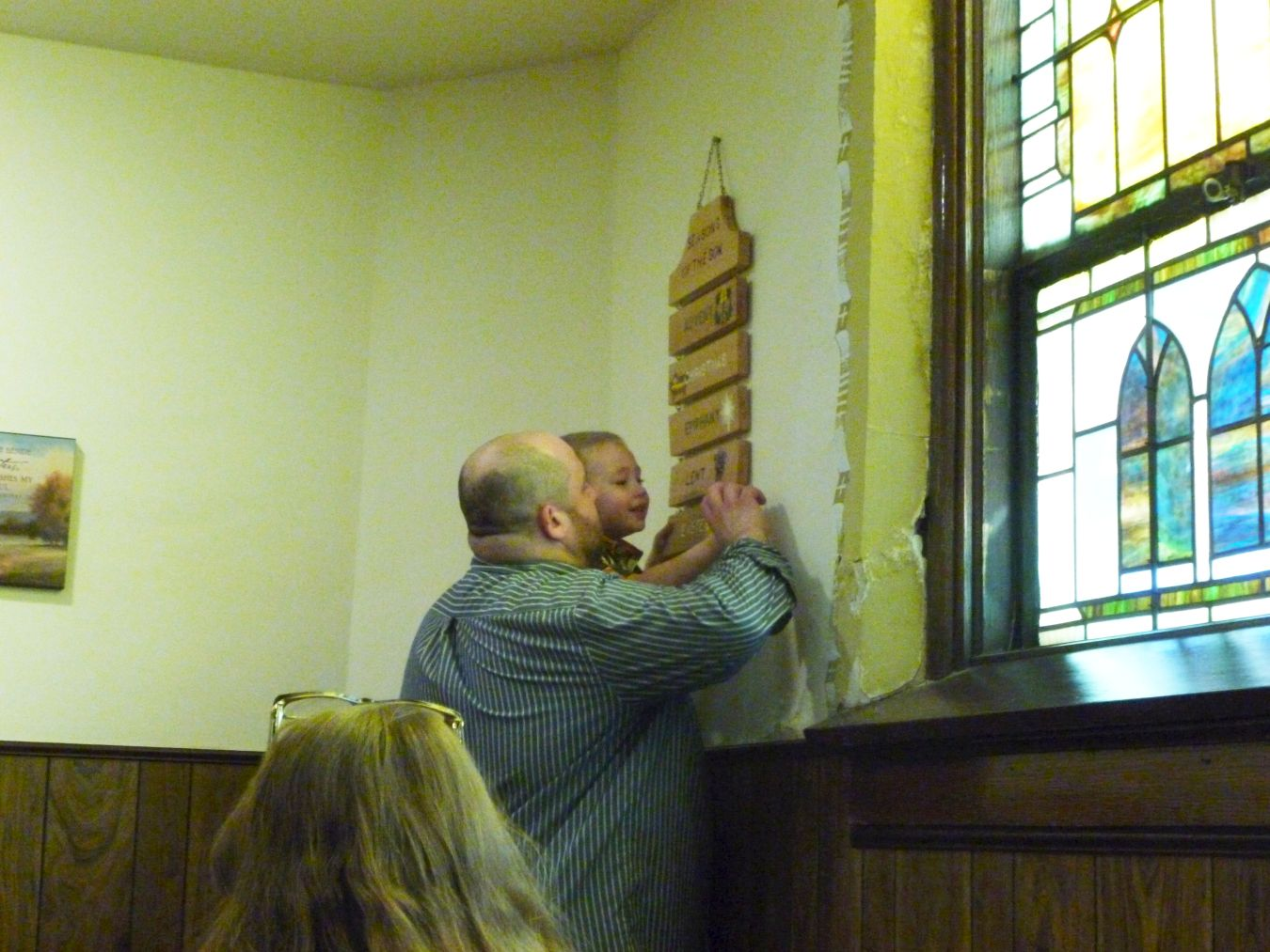 AJ hanging Easter plaque, Second Sunday of Easter 2018