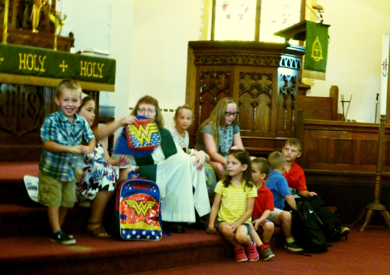 Pastor Karen blessing backpacks, 26 Aug 2018.